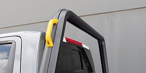 Comtruk handle for safer loading
